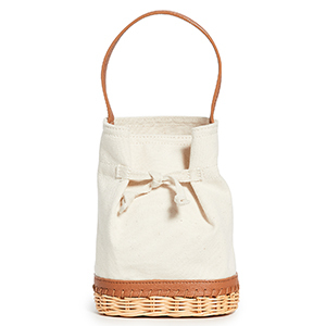 A canvas bucket bag with leather trip and a rattan base photo