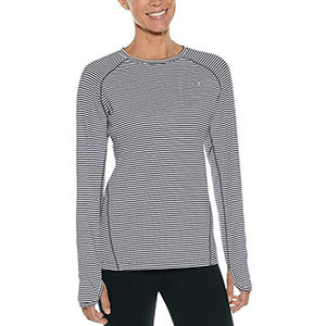 Woman wearing a black and white striped long sleeve and black pants photo