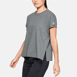 Woman wearing a baggy gray shirt with cuts in the sides photo