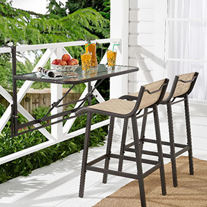 Deck with a hanging bar table and two bar chairs photo