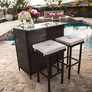 Wicker bar set with to cushioned stools photo