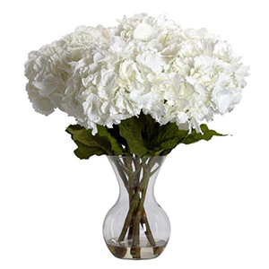 Large white hydrangea with a glass vase from The Home Depot photo