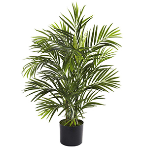 Indoor and outdoor faux palm tree with black pot from The Home Depot photo