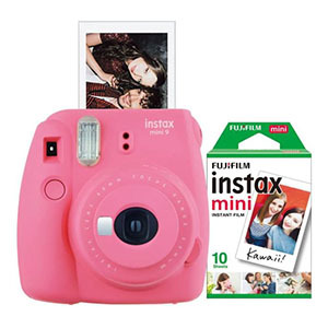 Pink instant camera with photograph photo