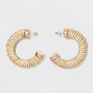 Product shot of two large hoop earrings photo