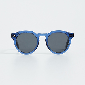 Product shot of blue sunglasses on a gray background photo