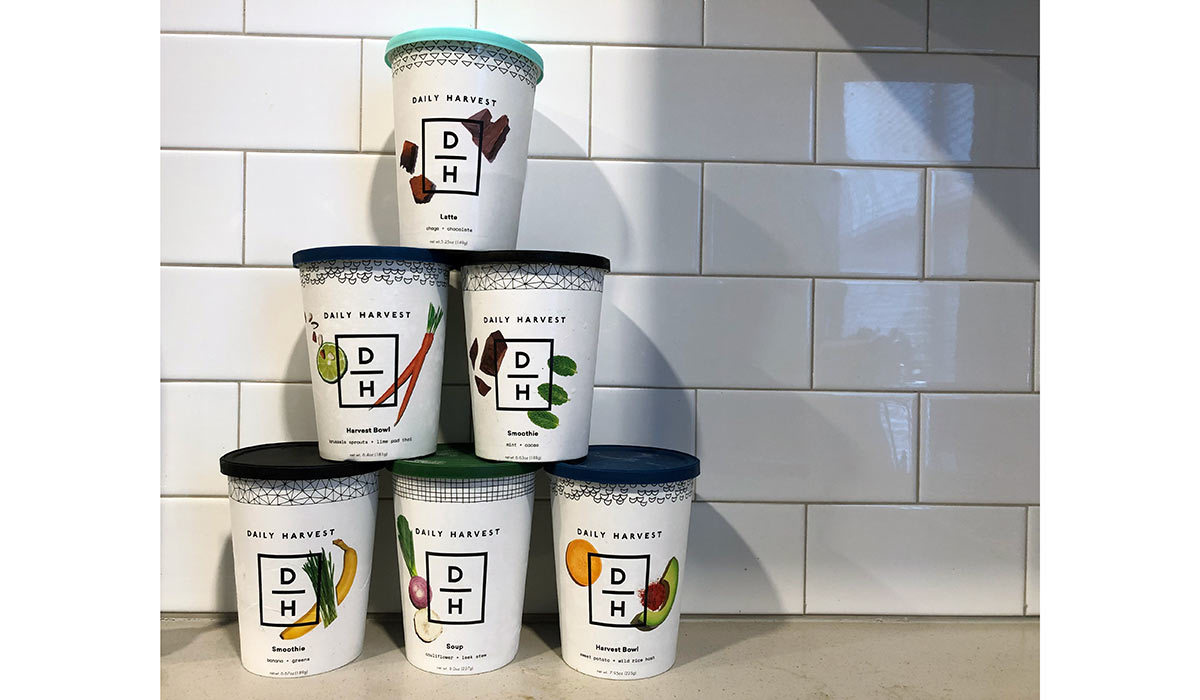 Pyramid stack of Daily Harvest food cups photo