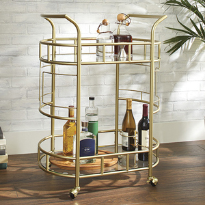 Gold bar cart with two shelves holding wine and spirits. photo