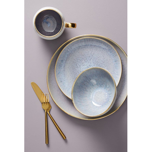 Lilac and gold hand-painted dinnerware collection including a bowl, dinner plate, mug, and dessert plate. photo
