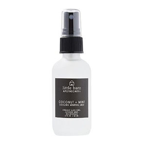 Small clear cooling spray bottle with black labeling photo