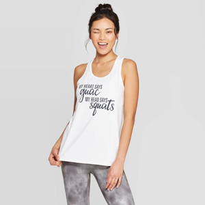 Woman winking at the camera wearing a white tank that says,