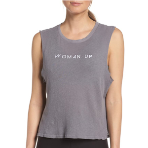 Woman wearing a charcoal gray crop tank that says,