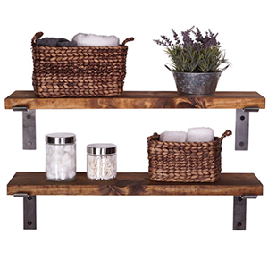 Brown wood shelves with metal brackets with baskets on top photo