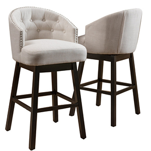 Two white upholstered bar stools with dark wood legs photo