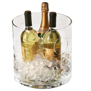 Clear glass ice bucket filled with ice and wine bottles photo