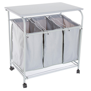 White laundry sorting station with ironing board on wheels photo