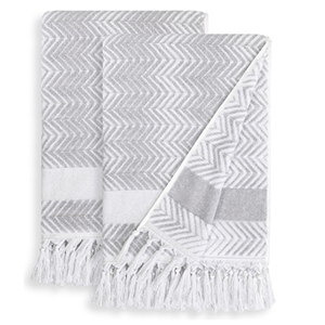 Gray and white zig-zag patterned bath towels with tassels photo