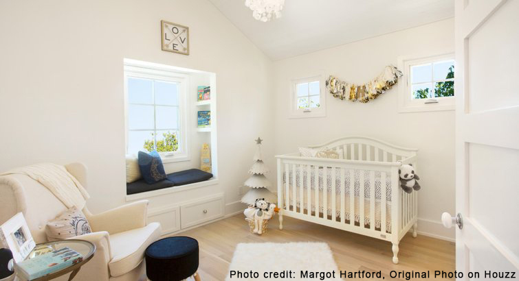 Light-colored nursery with rocking chair, crib, and decorations