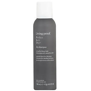 Gray spray can of Living Proof dry shampoo with white cap photo