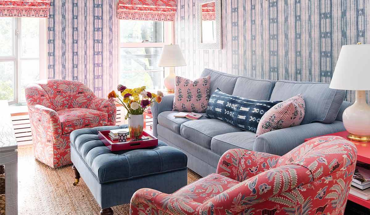 Blue and pink room with a couch and two chairs