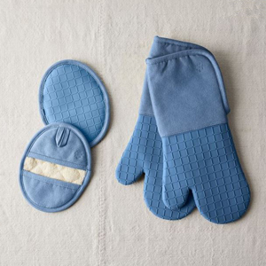 Set of two blue silicone oven mitts and pot holders photo