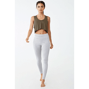 A woman wears gray leggings and an olive green crop top tank top photo