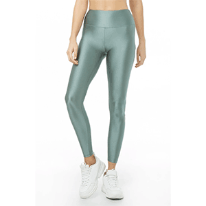 A woman wears green metallic leggings photo