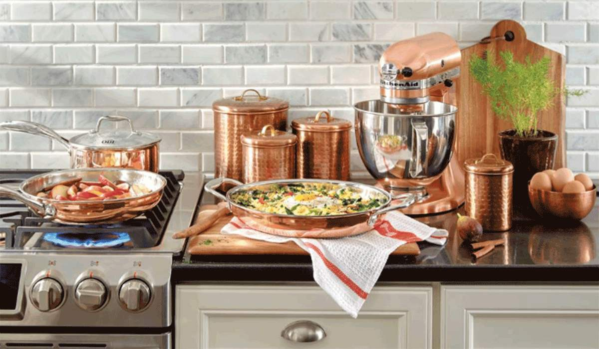 A kitchen full of copper accessories and KitchenAid appliances