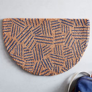 Half-circle doormat with geometric navy pattern on it for entryway photo