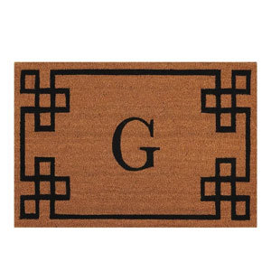 Simple doormat with a letter G on it a geometric border photo