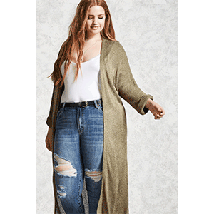 A woman wears an olive green duster cardigan with ripped jeans photo