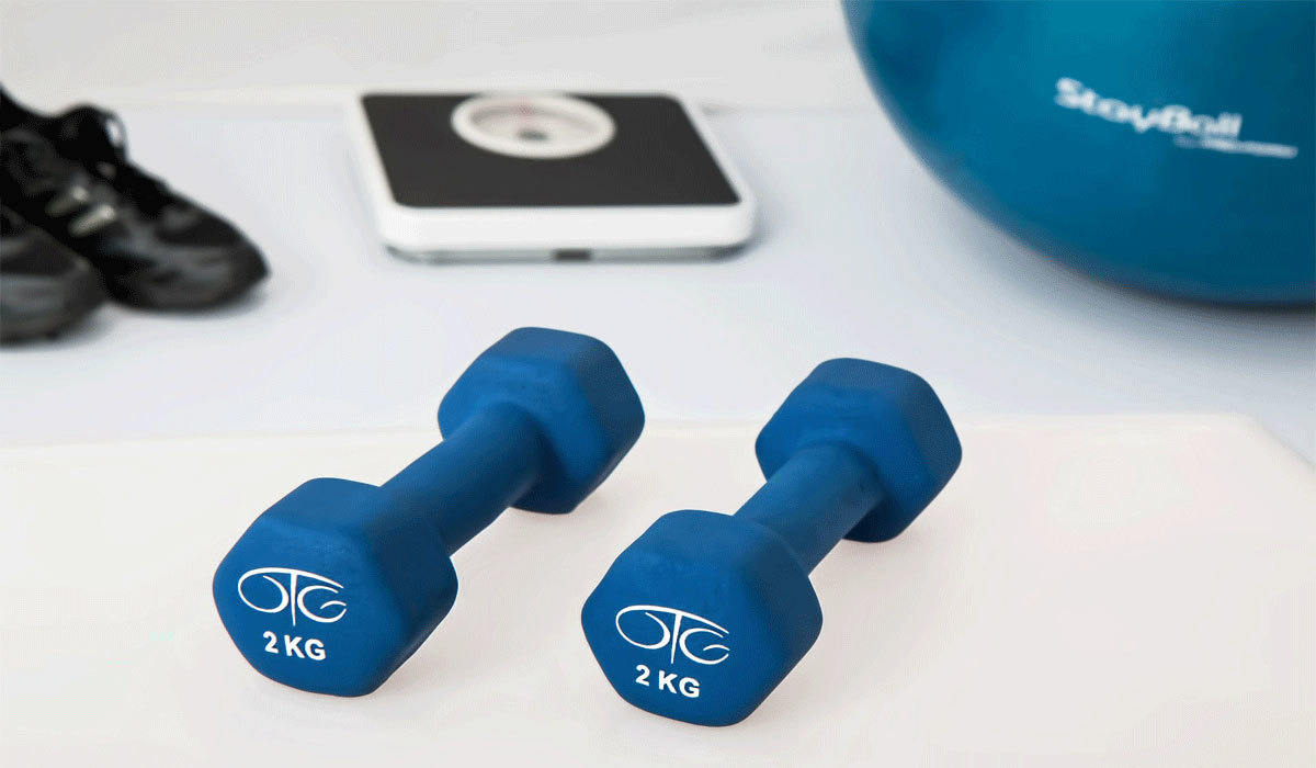 Pictured image of body weights and a medicine ball