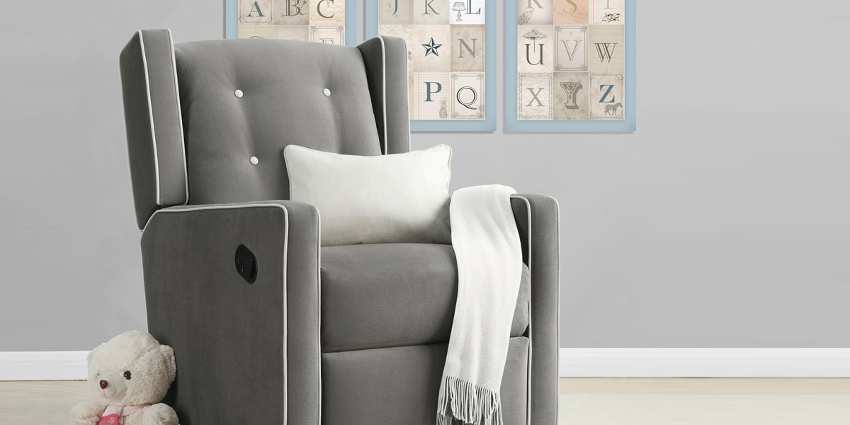 Gray swivel gliding recliner for a baby's nursery photo
