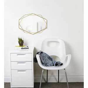 Accent mirror with a gold geometric frame from Joss & Main photo