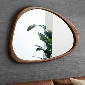 Asymmetrical wall mirror with acacia wood frame from West Elm photo