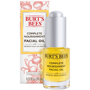 Yellow bottle of Burt's Bees facial oil and pink box photo