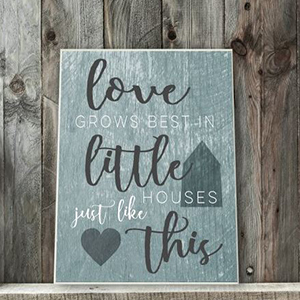 Blue and white wall plaque with the saying,
