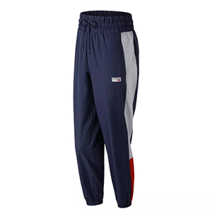 Navy blue wind pants with silver and red details down the side photo