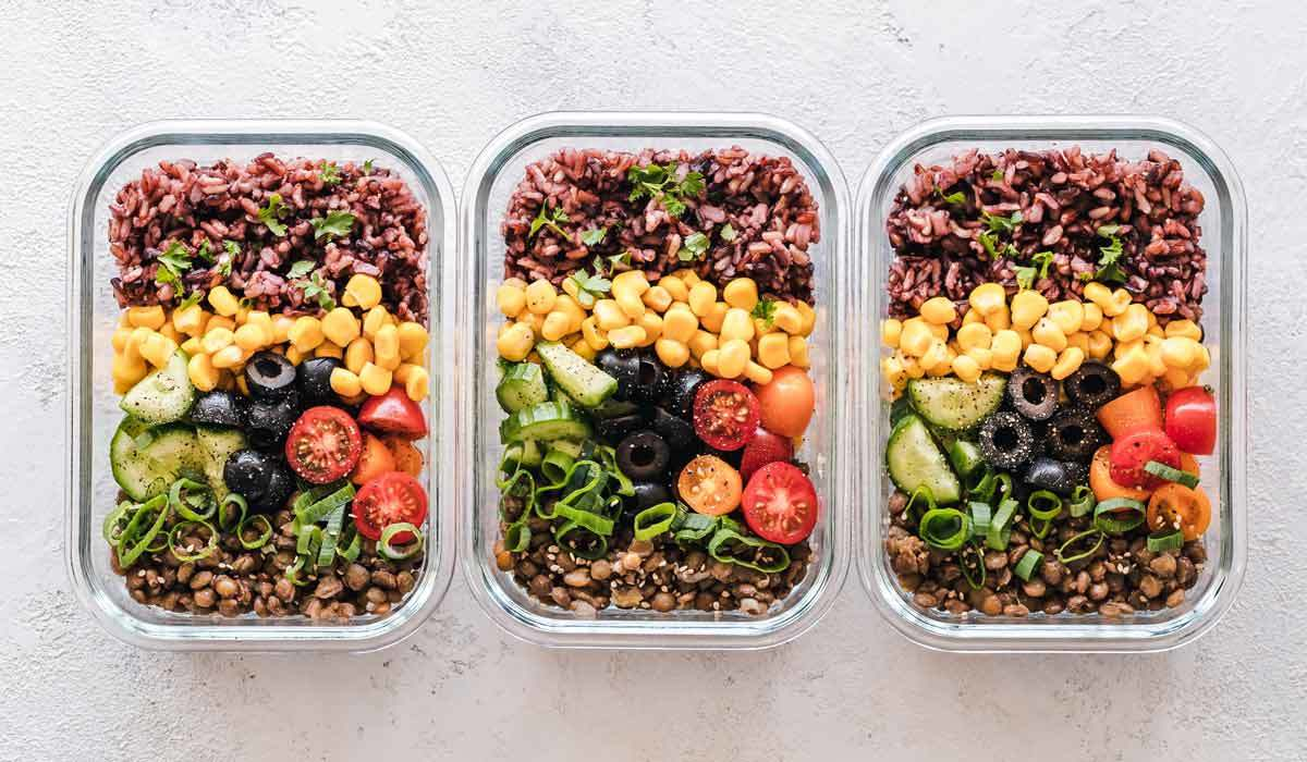 Three glass food storage containers holding healthy taco salad photo