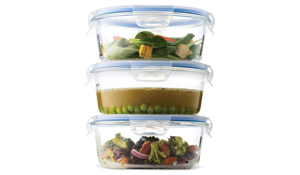 Three glass food storage containers from Amazon holding a salad, soup, and roasted veggies stacked on top of one another photo
