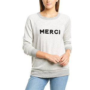 Woman wearing a gray sweatshirt with words