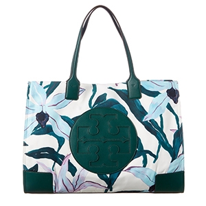Teal, white, and blue patterned Tory Burch purse photo