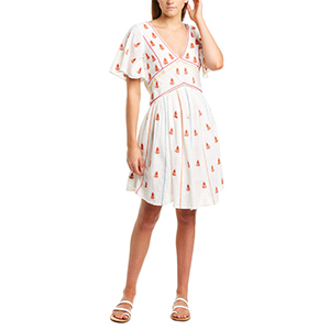 Woman wearing a white peasant embroidered mini dress photo