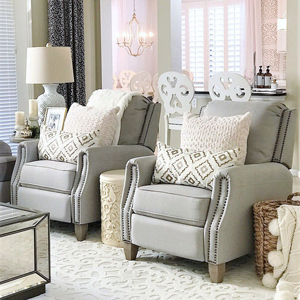 Living room with a pair of pushback recliners and toss pillows photo