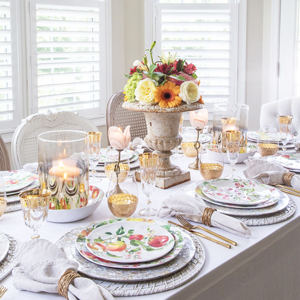 Table setting featuring gold ombre hurricanes and gold honeycomb stemless glasses photo