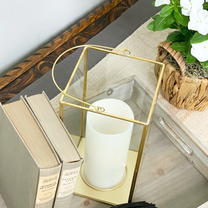Tabletop wooden tray with a metal and glass lantern photo