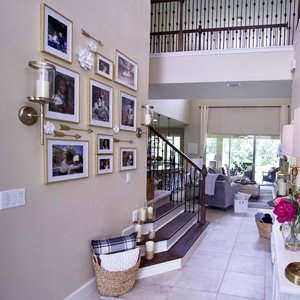 Gallery-style arrangement of photos in matted gold frames photo