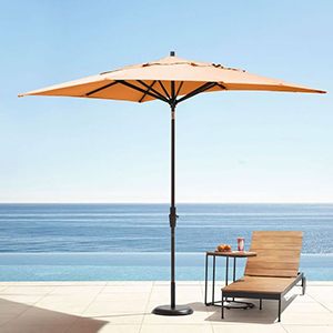 Orange umbrella with one chair and a side table photo