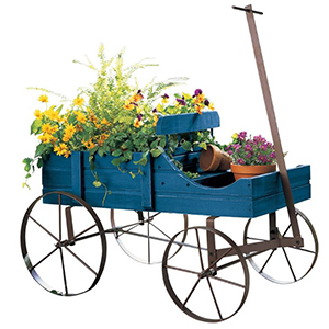 Blue wagon planter with flowers and pots photo