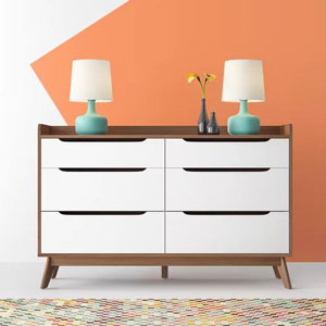 White and brown wooden dresser with six drawers from Wayfair on a white and orange background photo